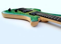 Motherplucker Guitars Mira... like the sandwich inlays between the top and body