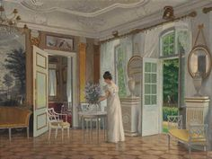 Adolf Heinrich Claus Hansen (Danish, 1859-1925) A lady in a sunlit interior signed and dated