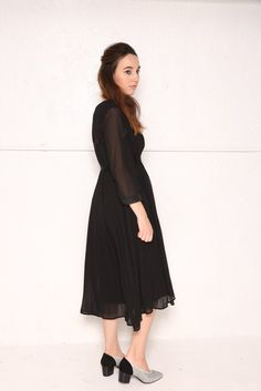 Sheer and long, pleated and full of movement, the TUFT dress glides with you and can be worn/styled in several ways. The side tie grow grain ribbons allow the w