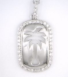 14KT WHITE GOLD DIAMOND PALMETTO PENDANT. (.50CTW) 142-11089