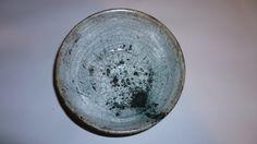 White raku glaze with iron oxide splattered on