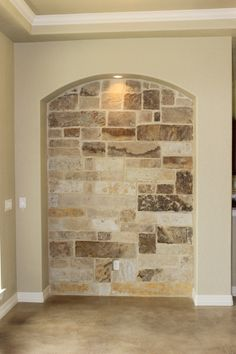 Stone wall & stained concrete floor
