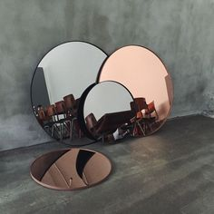 Mirrors in rosey copper and grey. /thecoveteur/