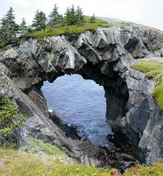 The Berry Head Arch in Newfoundland Located on the East Coast Trail to the south of St. John's, Newfoundland, Canada, is an incredible rock formation. Places Around The World, Oh The Places You'll Go, Places To Travel, Places To Visit, Around The Worlds, Travel Destinations, Travel Tips, Travel Hacks, Beautiful World