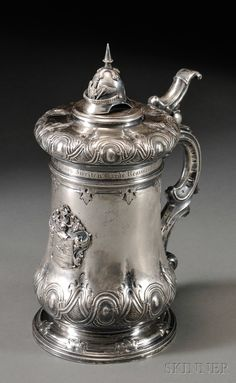 Not exactly a liquid refreshment but imagine this holding one?  German silver Tankard late 19th century