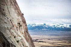Photo by @taylorglenn // A climber ascends a formation in Castle Rocks State Park Idaho this past weekend. In the distance snowy peaks hold on to what is left of winter. Now that Spring is here it's time to get out and enjoy the amazing public lands we are so fortunate to have.  Follow @taylorglenn for more from the West and beyond. #idaho #publicland #spring #travel #climbing