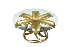 A gilt metal coffee table by Arthur Court in the style of a lily. The table base is in really good original condition, its made from a lightweight