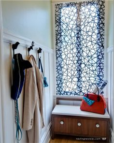 Why didn't I think of this? Tension rods on the bottom and the top of a panel of fabric for a quick and modern window treatment.