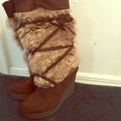 Beautiful Winter Brown Wedge Boots  Very comfrotable and warm Mocha Brown  Wedge boots. The fur is faux, but keeps the legs very warm. These are a little under the knees, so I wouldnt call them knee high boots. Also they have never been worn. No trades, price is very negotiable THRU the offer button ! Shoes Wedges