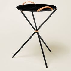 Finnish designer Tero Kuitunen focuses his work on the sensation of touch, using a variety of materials to bring about different sensations. The pieces he is showing at Habitare range from a set of red clay pots to tasselled mirrors.