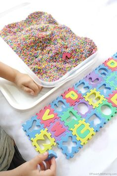Sensory ABC Activity also great for fine motor skills. toddlers love to search and find in the color rice and preschoolers call out what letters they find (Mix Babies Sensory Play) Toddler Play, Toddler Learning, Toddler Preschool, Toddler Activities, Teaching Toddlers Abc, Sensory Activities For Preschoolers, Fine Motor Activities For Kids, Preschool Literacy, Sensory Activities