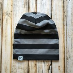 Trendy black and grey stripes. 1 thick stripes. This one only has 25% stretch, so make sure to size up if you are close to the next size!