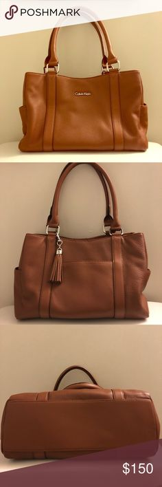 8136550ba9b2 Calvin Klein Genuine Leather Handbag Perfect condition leather handbag.  Plenty of room, two side pockets, one front pocket, and two main  compartments with ...