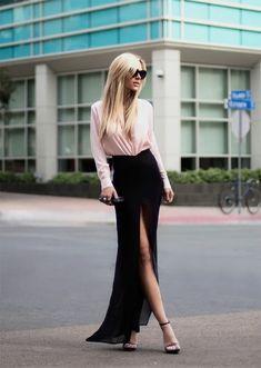 Femme élégante en noir et rose pale