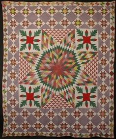 """Stars with Applique Quilt: Circa 1870; Pennsylvania -       Dense patterning makes this combination of Star of Bethlehem; Oakleaf; Variable Star and Hourglass a real knock-out. Graduated sizes of each frame add to the drama of the large central star. Colors and fabrics have mellowed with washing. Likely a unique combination of patterns. Measures 82"""" x 99""""; circa 1870. Pennsylvania origin. (Courtesy, Stella Rubin)"""