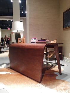 This waterfall desk by Steven Volpe for McGuire has a beautiful profile. Don't be deceived! The amount of science, technology and art that has gone into the creation of this piece is astounding. It's made of solid mahogany wood with a brass base and brass detailing on the legs.