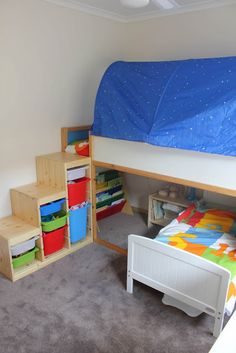 Toddler bed under Kura and Trofast as bunk bed steps