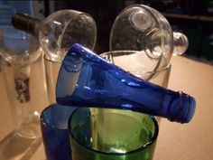 How to cut a glass bottle in 30 sec. BETTER THAN YARN AND FINGERNAIL POLISH REMOVER. (Seriously, if you are planning to cut glass, do yourself a favor and take the time to watch this video that compares different methods on Pinterest. Youll be glad you did!)