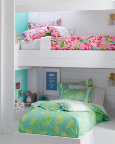 I like that the beds aren't identical, but have a common theme... I would like for the colors to be more similar though. Lilly Dorm Decor #homedecor, #lilies, #bestofpinterest, https://facebook.com/apps/application.php?id=106186096099420