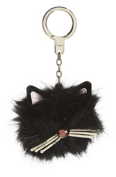 Add a fanciful feline flourish to the favorite handbag with this delightful faux-fur charm featuring cute cat ears and a shimmering nose and whiskers by Kate Spade.