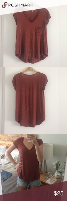 Bordeaux burnt orange v-neck tee The softest and cozier tee! Has a pocket on the left side. Although it's an XS, it could easily pass for a small or even medium because of its stretch. 94% rayon 6% spandex Anthropologie Tops Tees - Short Sleeve
