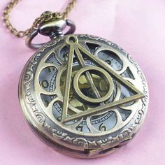 Deathly Hallows Pocket Watch, $4.10 | 56 Totally Wearable Harry Potter-Themed Accessories