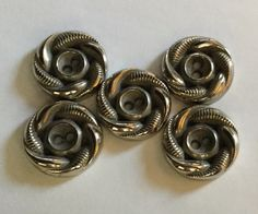 A personal favorite from my Etsy shop https://www.etsy.com/listing/267088555/vintage-silver-twist-buttons-set-of-5