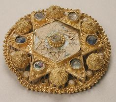 Brooch, c 970-1030, probably made in northern Italy, Ottoman, gold, pearls glass, cloisonné enamel