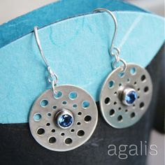 silver earrings by agalis