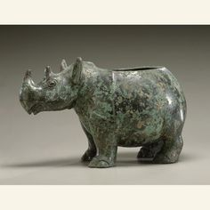 Traditionally, this Shang Dynasty animal-shaped bronze has been thought of as a type of wine vessel called a zun; this designation is supported by the inscription. The zun is a pouring vessel and with a spout, usually the head of the animal. There is, however, no spout and no opening between the head and body of this rhino vessel. Perhaps it held food?    http://67.52.109.59:8080/emuseum/view/objects/asitem/id/13169    Collection of the Asian Art Museum, SF