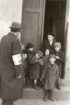 Krakow, Poland, Jewish children with a member of the ghetto health committee, 1940.