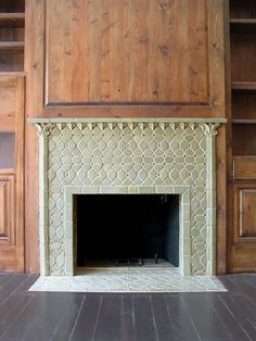 This unique fireplace tile installion was created by making interlocking tile patterns. A ceramic mantel was used here. Floors are walnut and the panelling is pine.