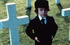 "THE OMEN (1976)  Father Brennan: ""He must DIE, Mr. Thorn!""    There are hellish goings-on when the American ambassador to Italy (Gregory Peck) swaps his stillborn child - at the suggestion of the hospital priest - for the baby of a woman who died in childbirth. Years go by uneventfully...until the grisly deaths begin. The child's nanny hangs herself and a priest is speared to death in a freak accident. Why - because Gregory has inadvertently adopted the antichrist."