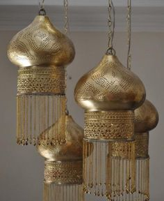 Beautiful Moroccan chandelier the gold ooooozzes luxury but remains  some what subdued as traditional Moroccan style is bright colours