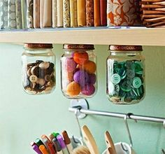 Save space and show off your buttons by storing them in mason jars attached to the bottom of your shelves.
