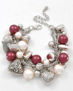 So pretty for Valentines Day! Heart Charm Bracelet #jewelrymaking #jewelryinspo #beadlove