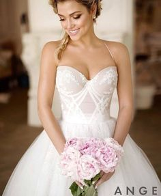Wedding dress: I love the top part of this dress so much. I love the neckline and the look. Realy everything about it.