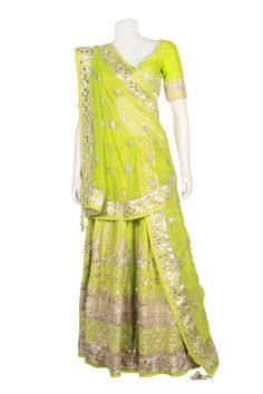 Bring bridal thoughts within yourself by wearing this lemon green bridal lehenga choli. This bridal lehenga choli is magnificently crafted in zari, resham and stone work. The flawless choli in contras