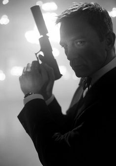James Bond, 007. (with a Walther P99).. and that menacing  smoldering look to go with it.. Daniel Craig.. ❤