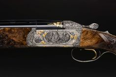 "Krieghoff Gun of the Year 2009 showcases the talents of Master Engraver Jana Schilling. Bringing a fresh eye to a traditional art, Ms. Schilling engraved Krieghoff's ""Grand Old Lady"" – the K-80 – in breathtaking full coverage detail."