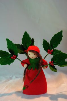 Holly Flower Child Waldorf Inspired by KatjasFlowerfairys... The little Holly is made of 100 % wool-felt, fairy tale-wool and tricot material. The doll is approx. 13,5 centimeters high  The filling is sheep wool