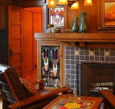 Would love to incorporate the leaded glass doors we have from my mom's childhood home into a fireplace remodel, like this.
