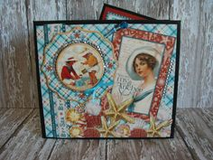 Mini Album Graphic 45® By the Sea Collection by Green Butterfly, Etsy: This little seaside themed beauty has only six pages but as you will see the pages open up and reveal an amazing amount of room for your favorite pictures. There over thirty tags in this album allowing so much room for photographs and journaling that you will be amazed at how much it can hold.