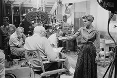 Howard Hawks directing Angie Dickinson in scene with John Wayne on Rio Bravo (1959)