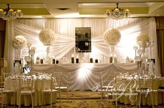 Ivory Head Table | Rachel A. Clingen Wedding & Event Design...I like the draping of the head table