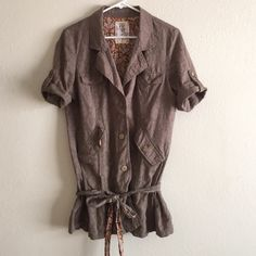 Free people safari top Lightweight cotton button front shirt, can also be used as a jacket for layering!! Green (taupe) with floral lining!! Ties at the bottom! Excellent condition! I love this one...I wear it with my voile slip dress and also jeans and a shirt!! It's a great layering piece!! Free People Tops Button Down Shirts