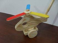 Resultado de imagem para helicoptero de brinquedo de madeira  com cabo