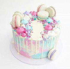 Pastel drip cake with macarons