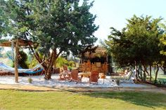 Husband wants a tiki bar in our backyard beach. This one looks fab!