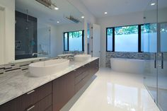 Floating bathroom cabinet. Like this look but with under mount sinks